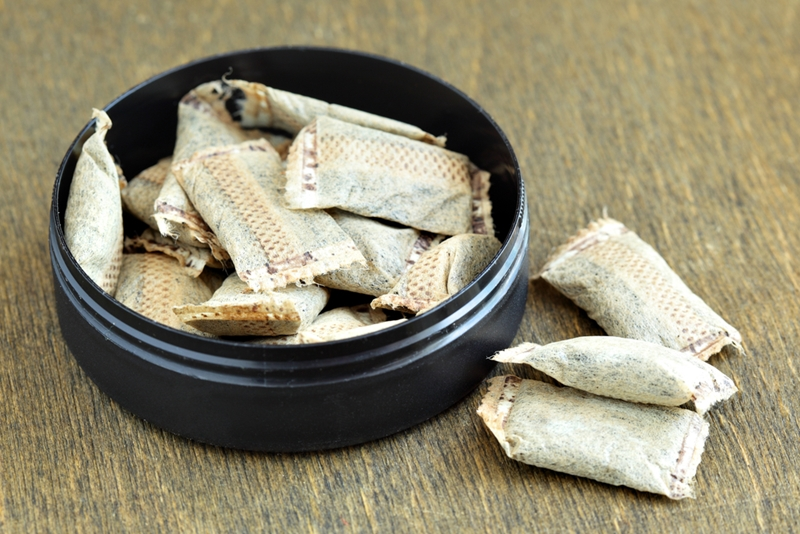 Smokeless tobacco in container.