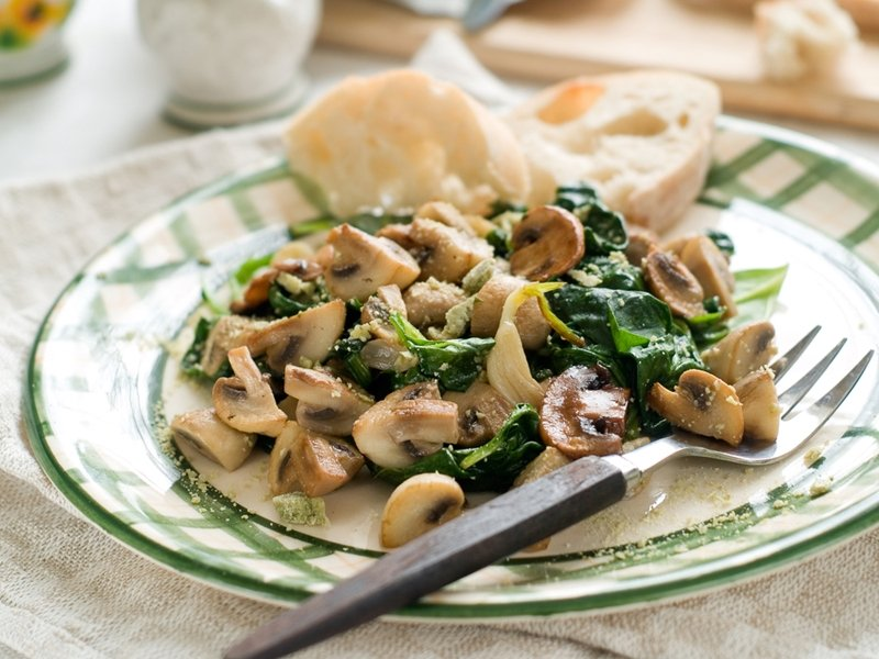 Mushroom and spinach mix on plate.