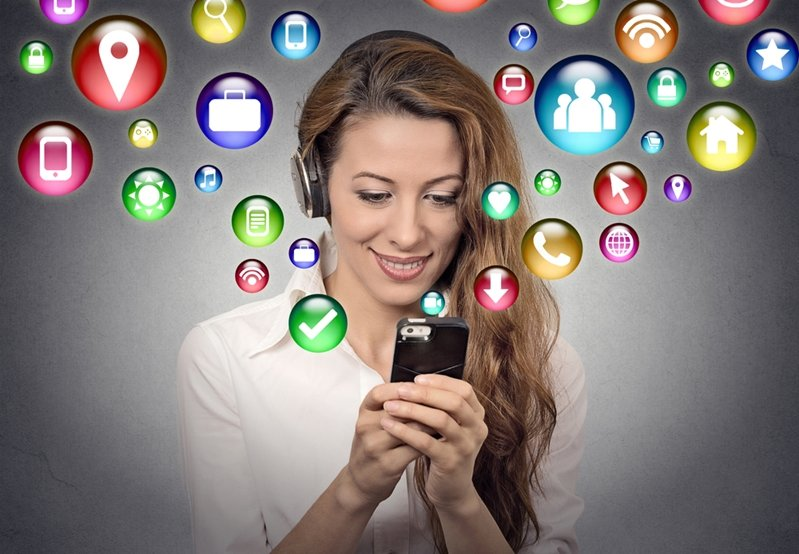Woman on smartphone viewing dental health apps.