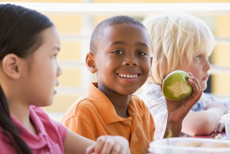 Pack fruits and vegetables in your kids' lunches to promote a healthy smile.