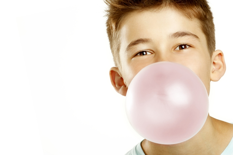 The sugar in gum can react with plaque to create acid.