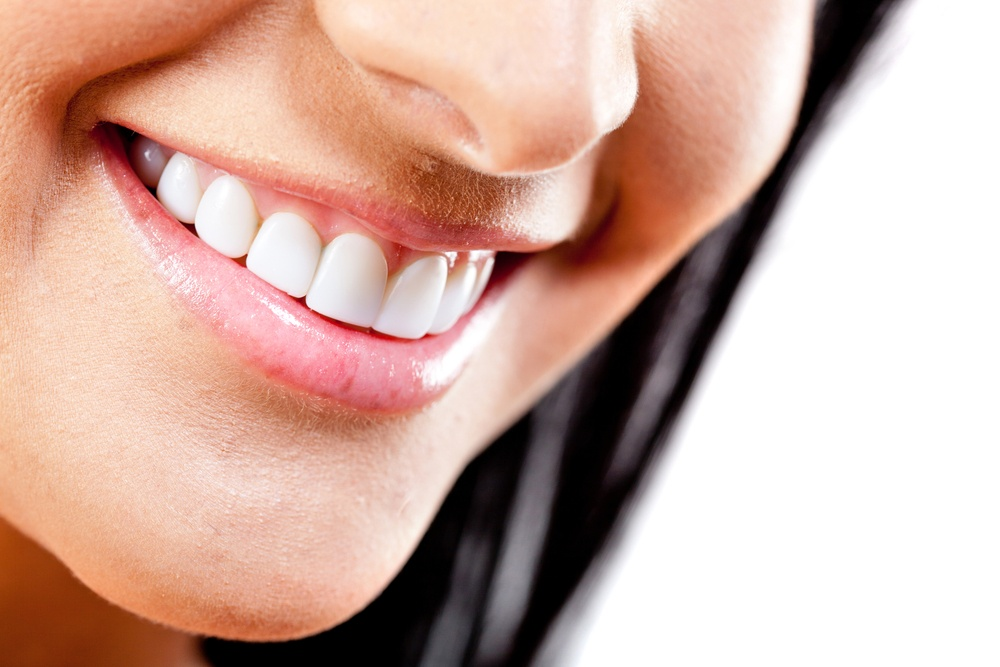 Beautiful smile of young woman with white teeth