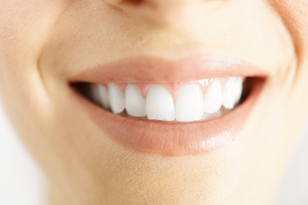 Detail of a woman smile showing white clean teeth