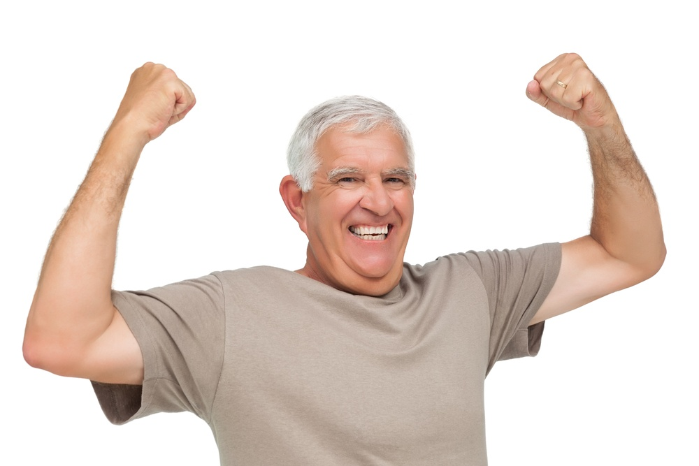 Cheerful senior man with clenched fists