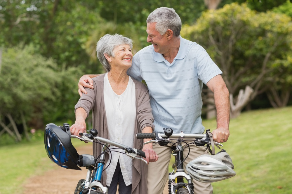 Senior couple on cycle ride at the park