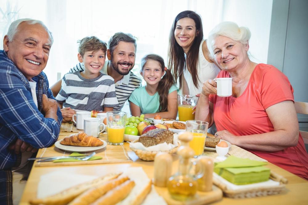 Happy multi-generation family sitting at holiday breakfast