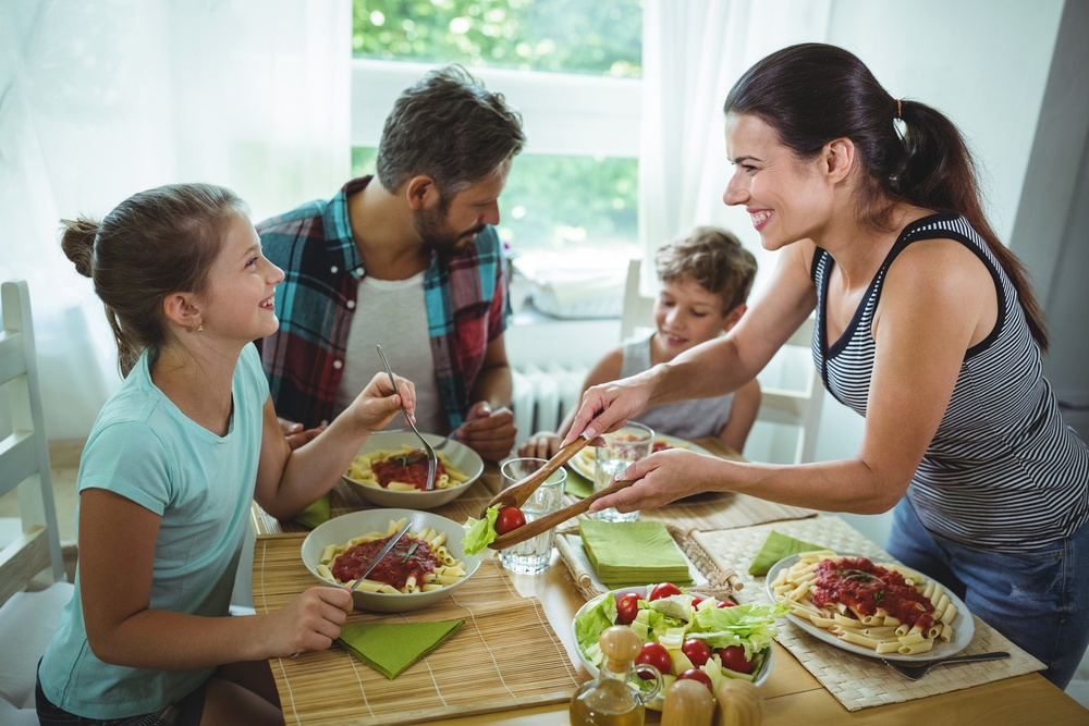 Family eating healthy foods that have positive effects on oral health