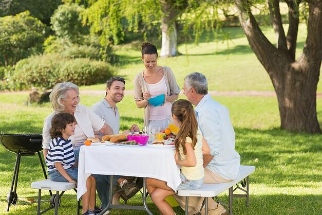 View of extended family dining at outdoor table
