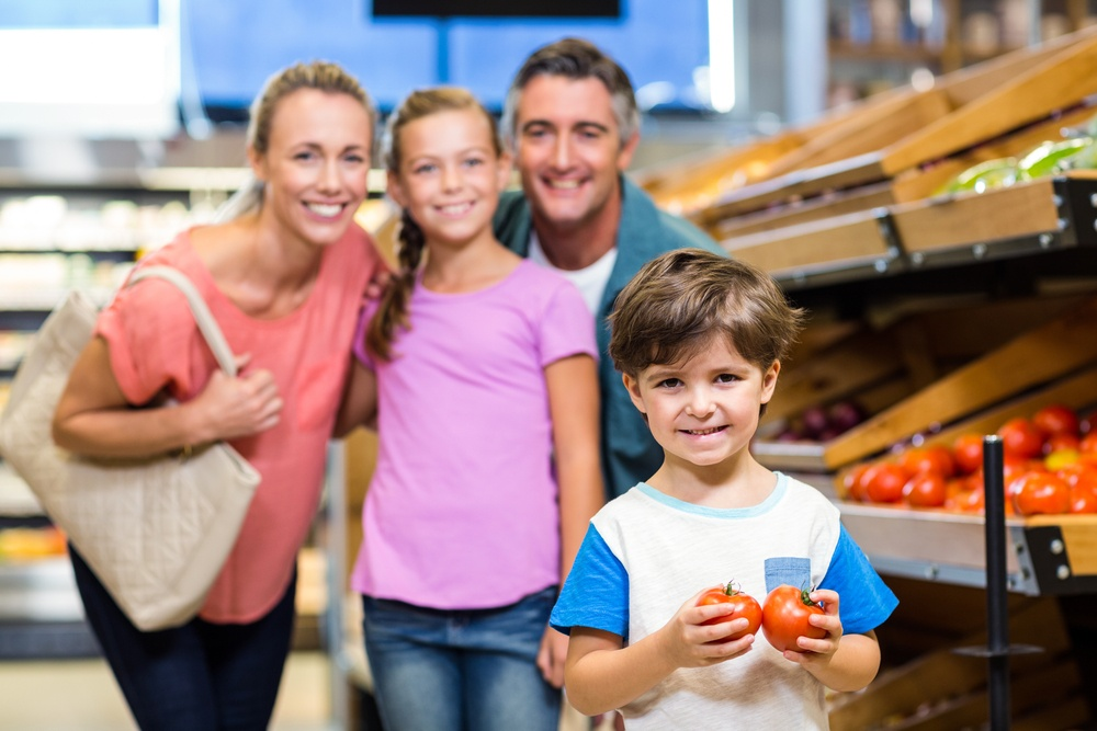 Young family doing some shopping at supermarket