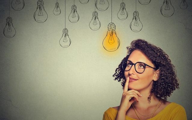 Thinking-woman-glasses-looking-up-at-light-bulbs.jpeg