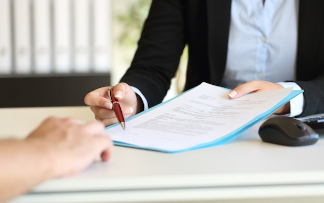 associate presenting form to sign