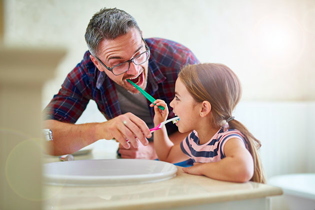 dad-daughter-brushing-teeth.png
