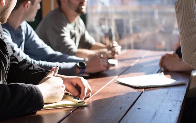 millennials sitting on bench office table.jpg