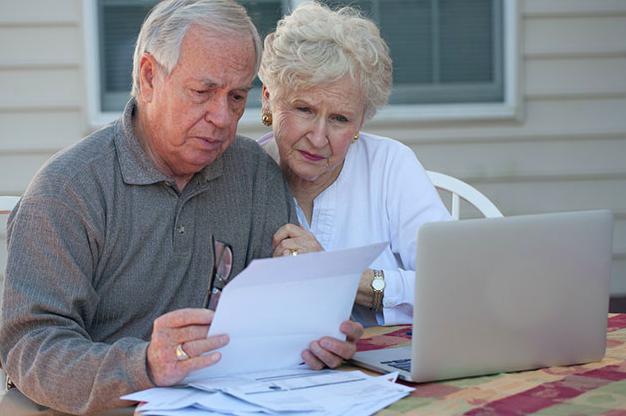 seniors-reviewing-finances.png